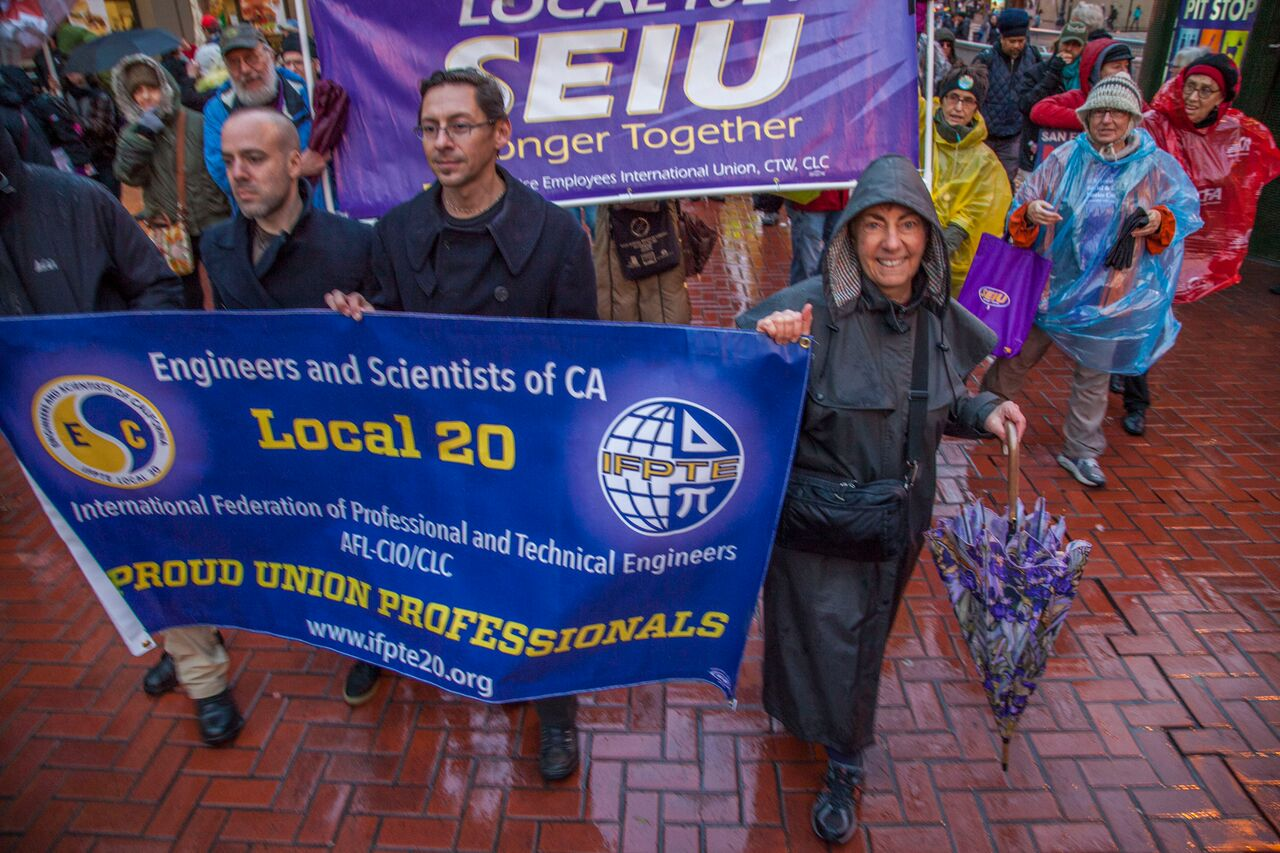 Kathy Setian and other members of IFPTE Local 20 march at the Inauguration protest on January 20th in San Francisco.