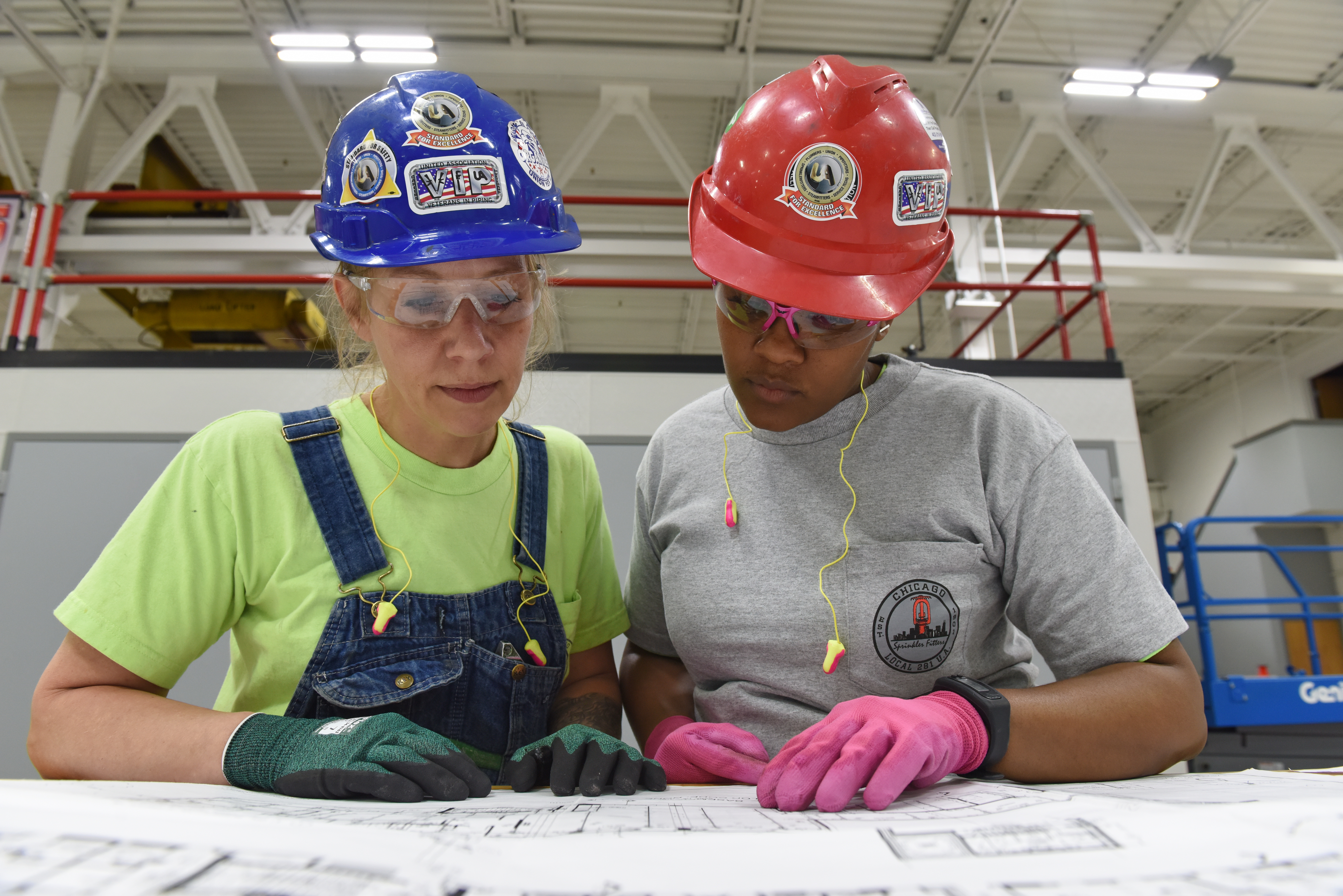 Women wearing hardhats