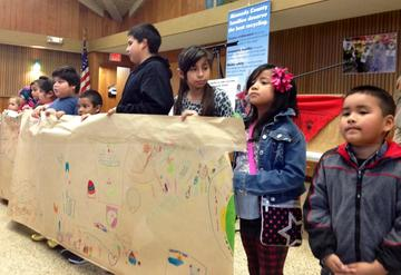 Children of recycling workers made a mural that they displayed at the conclusion of the convention on Feb 2.