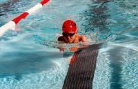 Nathan competing in a swim meet in 1997.